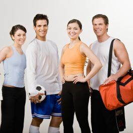 Soccer player and athletic friends in sportswear
