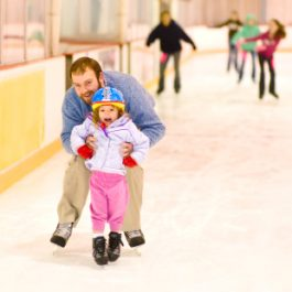Father and Daughter at Ice Skating Rink