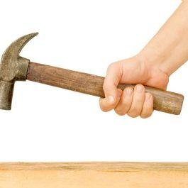 Hammer and Nail Using hammer and nail on wood